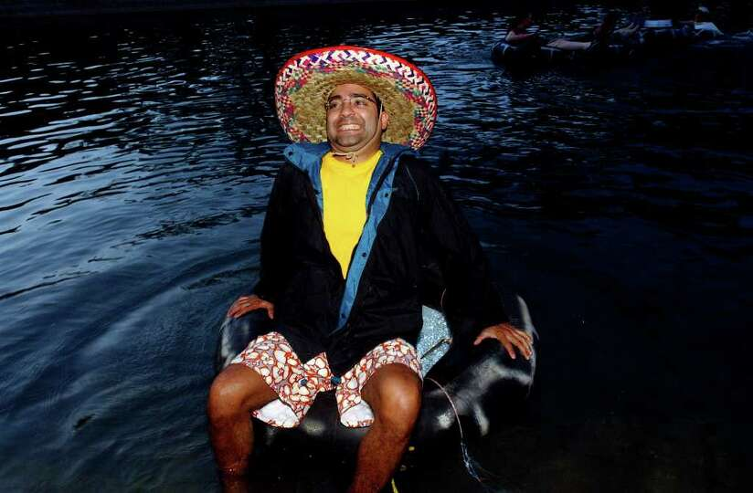 METRO  Daniel Ramon cringes as he feels the cold water temperature of the Comal River Saturday night