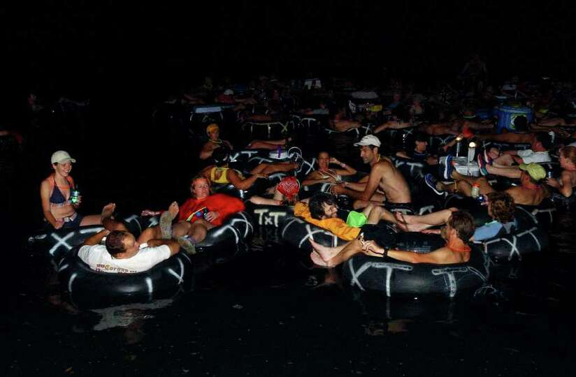METRO  Night tubers  float down the Comal River in New Braunfels Saturday during an Adventure Club o