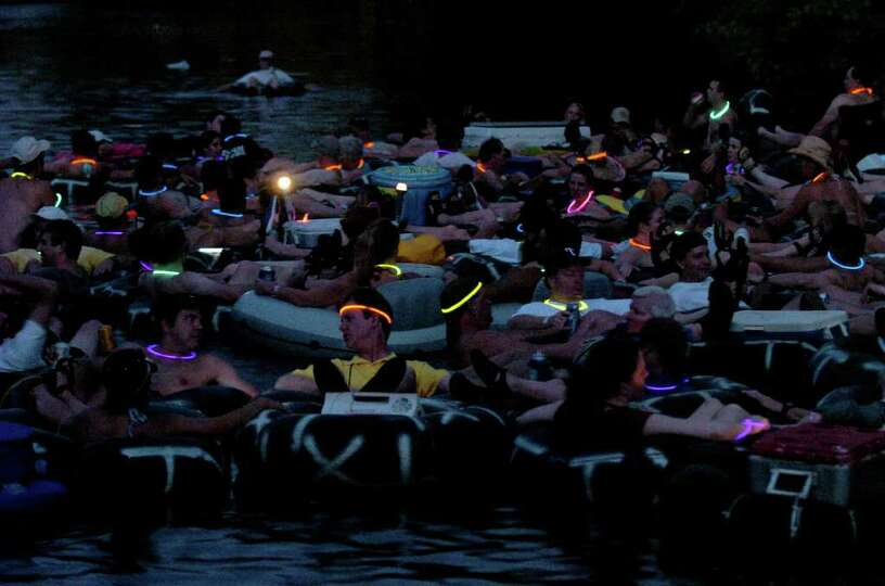 METRO  The adventure club flotilla of partying tubers makes it's way down the Comal River Saturday n