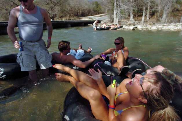 Courtney Phillips and other friends from College Station enjoy an afternoon of tubing on the Guadalupe River in Gruene on Friday, March 10, 2006. Water levels are low, and they sometimes got caught on the rocks in the river bed. BILLY CALZADA / STAFF Photo: BILLY CALZADA, SAN ANTONIO EXPRESS-NEWS / SAN ANTONIO EXPRESS-NEWS