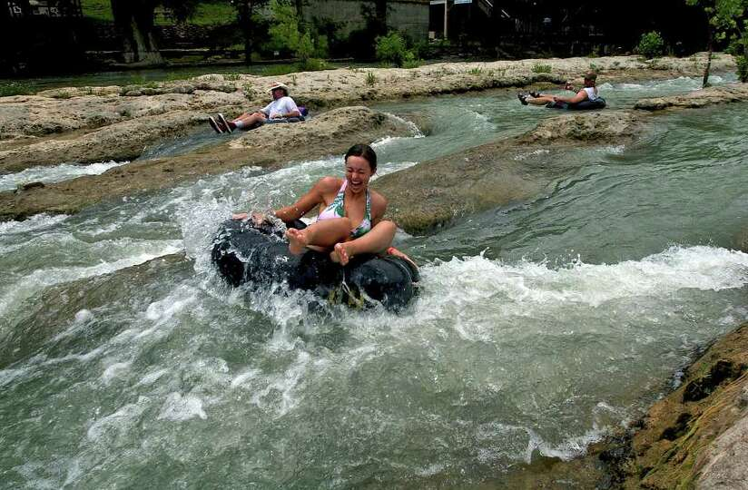 METR O  A tuber thrills as she splashes into the white water of
