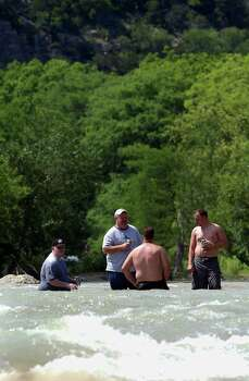 METR O   A group of men relax while the cool waters of the Guadalupe River north of New Braunfels rush by Monday.  TUBING ON THE GUADALUPE RIVER MAY 30, 2005  TOM REEL/STAFF Photo: TOM REEL, SAN ANTONIO EXPRESS-NEWS