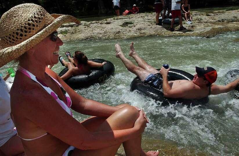 METR O   Margo Hoskins enjoys the antics of tubers sliding through