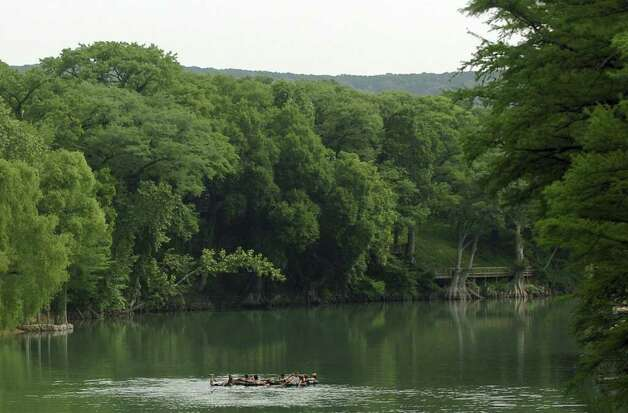Tubers drift on the Guadalupe River, Thursday, May 26, 2005, near Sattler, Texas. Thousands of tubers are expected to float down the river this Memorial Day weekend. Photo: TOM REEL, AP / SAN ANTONIO EXPRESS-NEWS