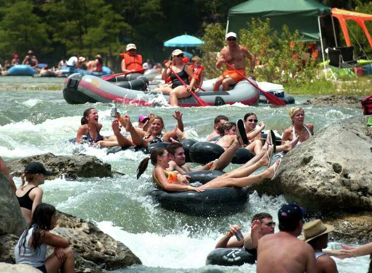 Metro daily - Forth of July tubers prepare to go down Huaco (CQ)  Falls on the Guadalupe River near