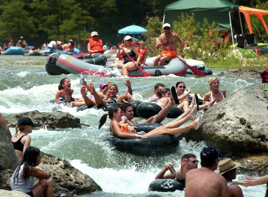 Forth of July tubers prepare to go down Huaco (CQ)  Falls on the Guadalupe River near New Braunfels, Tx. as the popular event draws crowds to enjoy the cool waters, Saturday, July 3, 2004. Photo: BOB OWEN, SAN ANTONIO EXPRESS-NEWS / SAN ANTONIO EXPRESS-NEWS