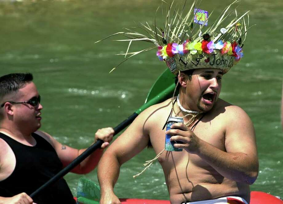 "A rafter with a hat that read ""I Love John Denver"" braces for a series of rapids on the Guadalupe River above New Braunfels.  Photo: TOM REEL, SAN ANTONIO EXPRESS-NEWS / SAN ANTONIO EXPRESS-NEWS"