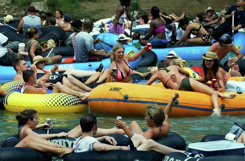 METRO   Tubers and rafters party it up on the Guadalupe River Saturday afternoon.  TUBING ON THE GUA