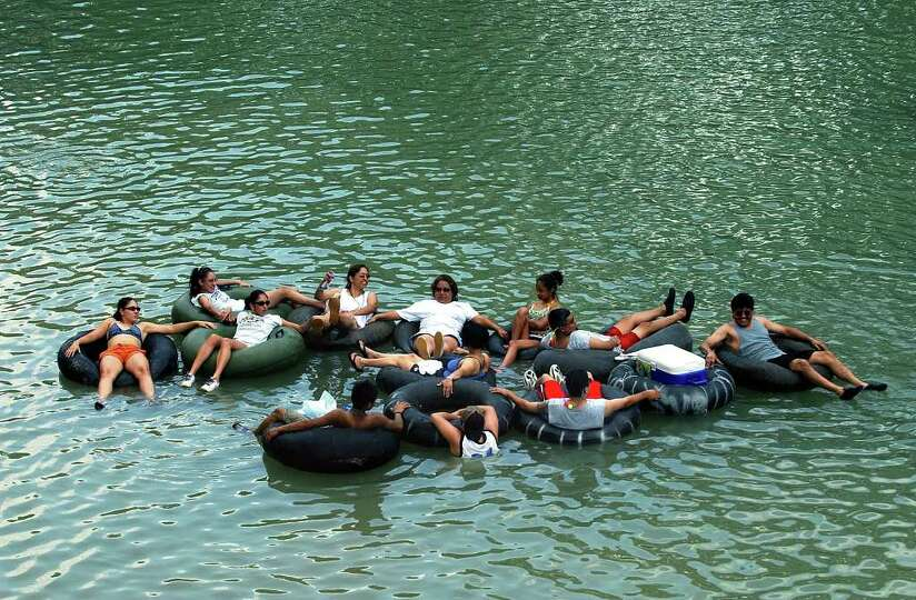 METRO   A family group hits the cool waters of the Guadalupe River at the FM306 launch site Saturday