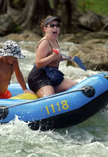 METRO -Sandy Price yells with excitment after making it through the rapids near the  Gruene bridge o