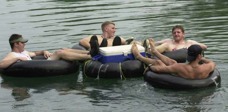 FILE --- With a tube just for the icechest friends from Southwest Texas State University cool off in
