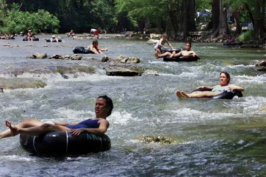 "ADVANCE FOR SUNS/BOB STEWART  Tubers make their way down the Guadalupe River in the ""horse shoe"" are below Canyon Lake Thursday, June 28.  The water was running just fast enough for slow tubing.  CREDIT: TOM REEL/STAFF Photo: TOM REEL"