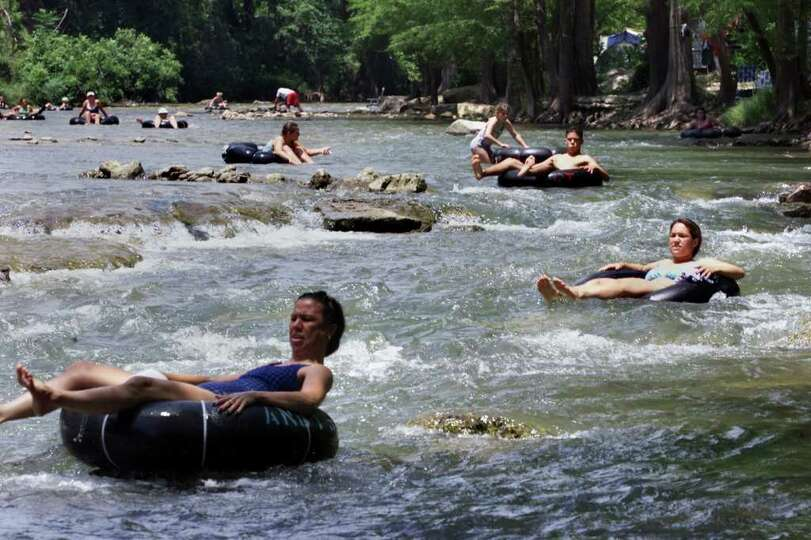 STATE  Tubers make their way down the Guadalupe River in the
