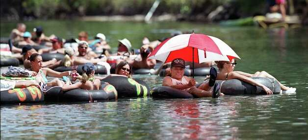 Metro/State:  Luis Ayala of ColLege Station, Texas beats the Labor Day weekend heat by shielding himself 