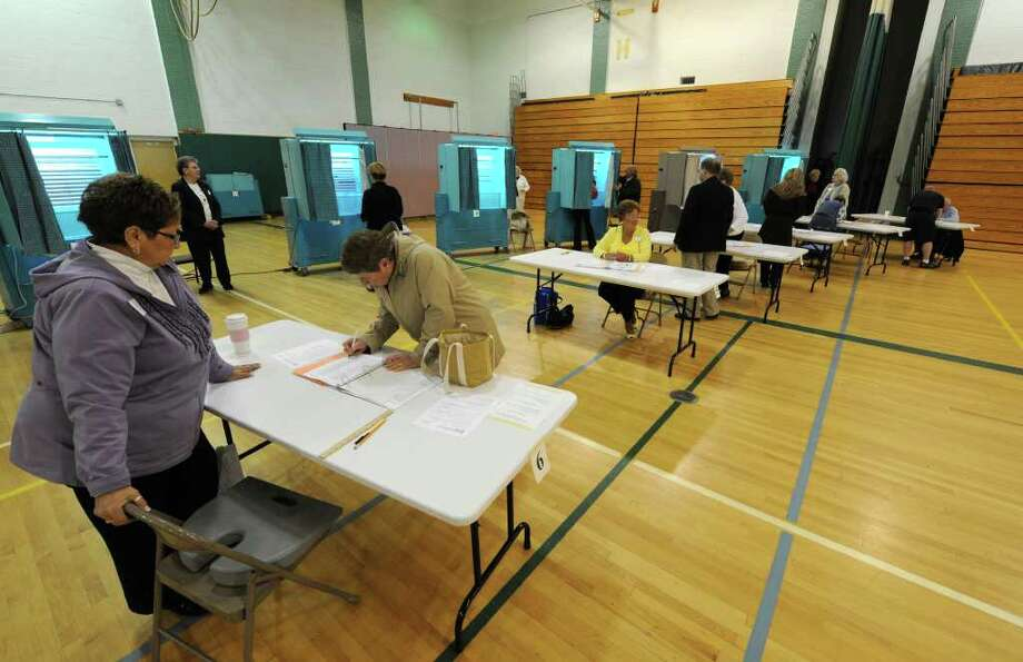 Voting was heavy Tuesday morning when the polls opened at  Gowana Middle School for the Shenendehowa school budget vote in Clifton Park. (Skip Dickstein / Times Union) Photo: Skip Dickstein