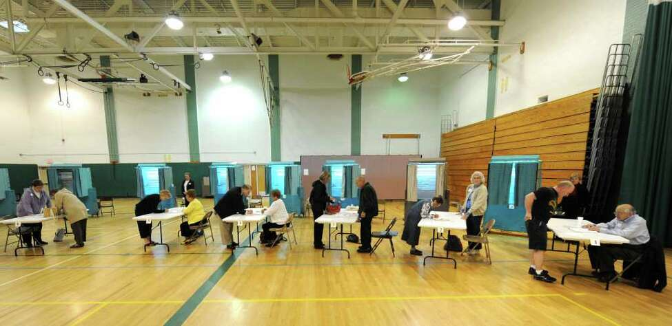 Voting was heavy Tuesday morning when the polls opened at Gowana Middle School for the Shenendehowa school budget vote in Clifton Park. (Skip Dickstein / Times Union)