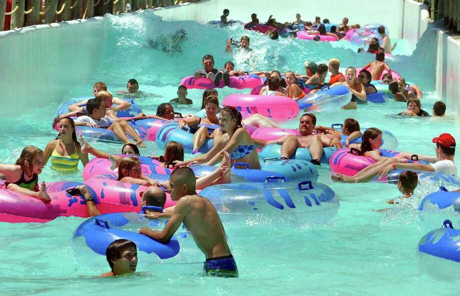 Schlitterbahn guests crowd the park on Wednesday, July 24, 2002.  The Water recreation park is open and doing a brisk business after the flooding caused a temporary set back earlier this month.  Photo: TOM REEL , SAN ANTONIO EXPRESS-NEWS / SAN ANTONIO EXPRESS-NEWS