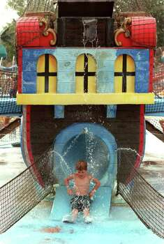 A young boy comes off of a slide shaped like a pirate ship in the Surfen Berg area of Schlitterbahn. Photo: STEWART F. HOUSE, File 96-