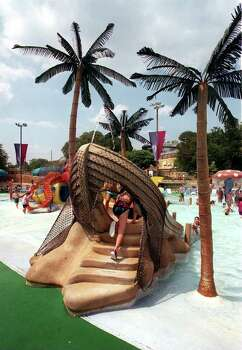 A youth tries out one of the many creative slides at the Schlitterbahn water park in New Braunfels. Photo: STEWART F. HOUSE, File 96-