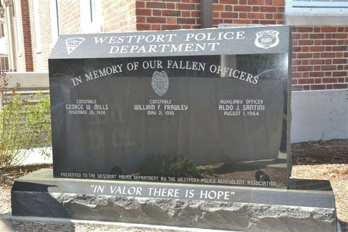 Pictured is the new Westport Police Memorial that pays tribute to three men who have died in the line of duty. In addition to the Westport Police Benevolent Association paying for the stone, local businesses donated a total of $40,000 worth of time and materials.