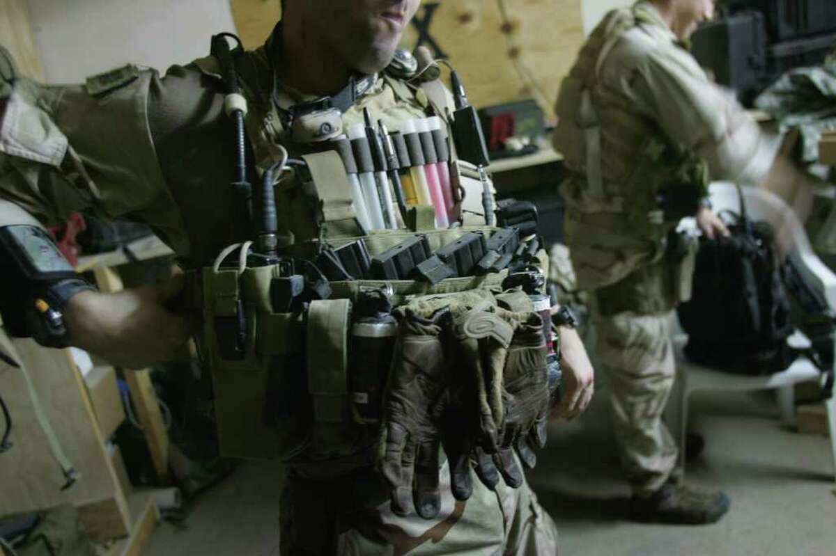FALLUJAH, IRAQ - JULY 27: U.S. Navy SEALS prepare for a night mission to capture Iraqi insurgent leaders July 27, 2007 near Fallujah, Iraq. American Special Forces operate throughout Iraq, targeting