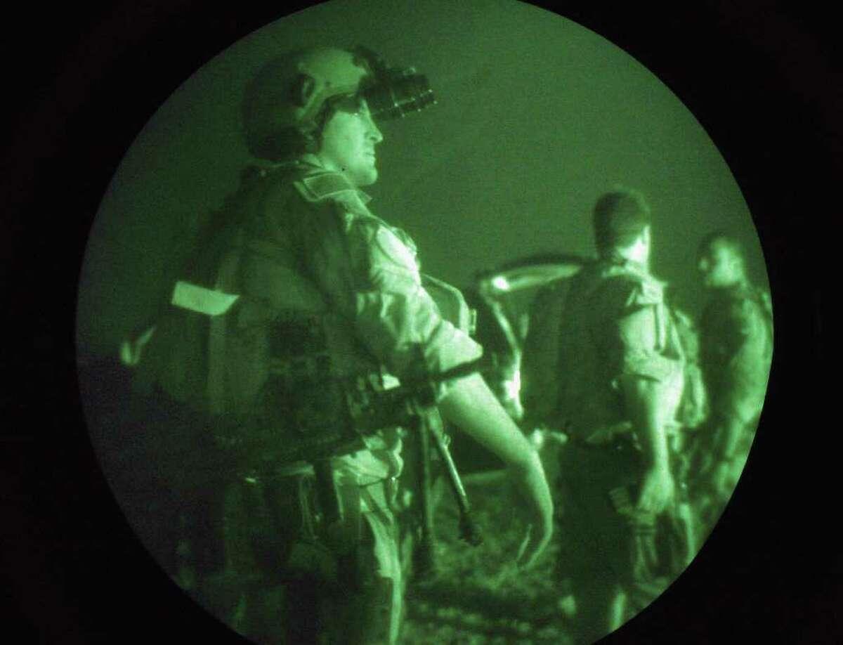 FALLUJAH, IRAQ - JULY 27: U.S. Navy SEALS await a night mission to capture Iraqi insurgent leaders July 27, 2007 near Fallujah, Iraq. American Special Forces operate throughout Iraq, targeting