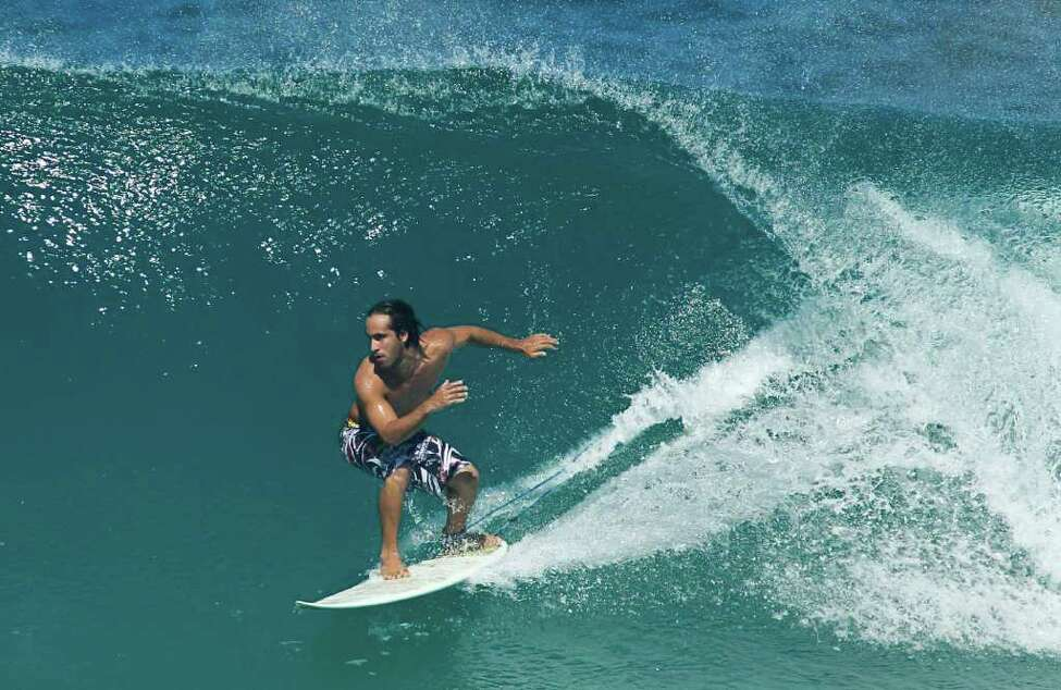 Jadson Andre, of Brazil, trains before the start of the Billabong Rio Pro surfing championship in Rio de Janeiro, Brazil, Wednesday, May 11, 2011. The start of the Billabong Rio Pro was postponed to Thursday due to to six foot (2 meters) closeout waves.