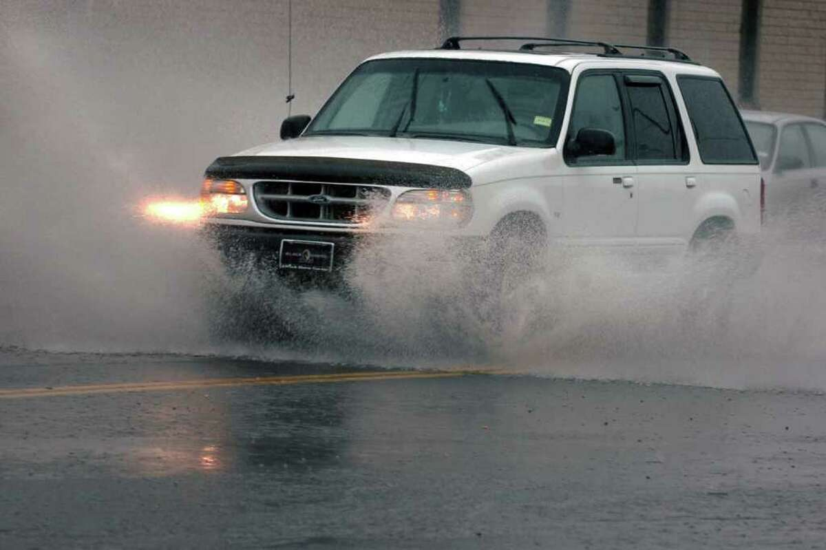 An SUV drives through a flooded section of Stratford Ave. in Stratford, Conn. during the rain May 17th, 2011.