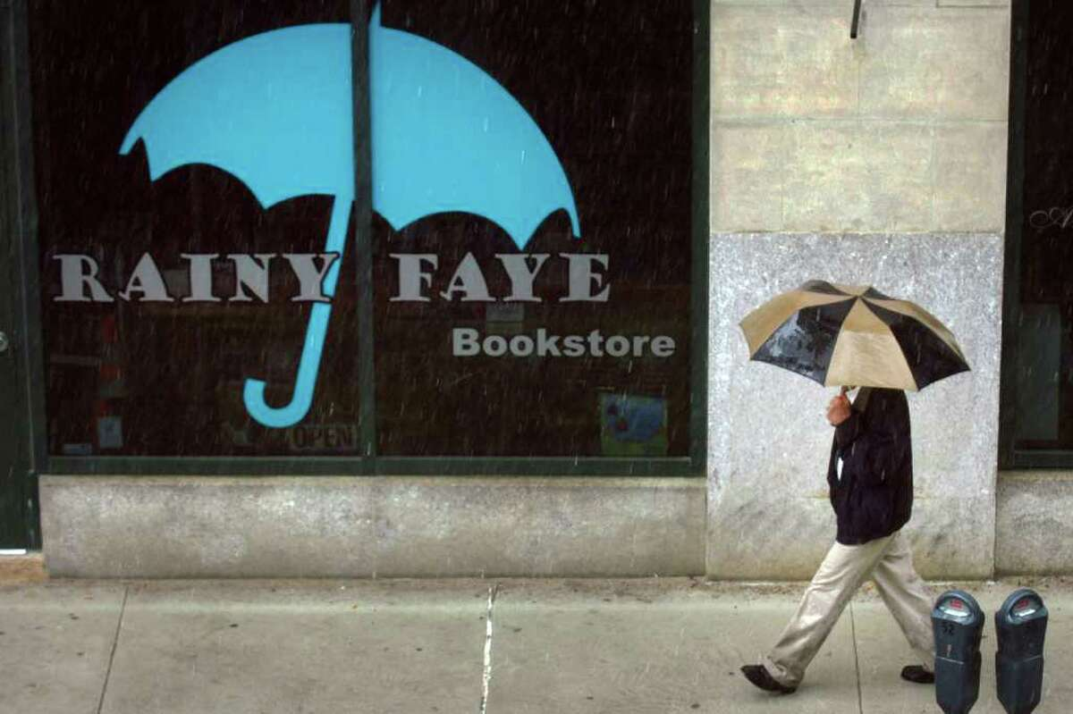 A pedestrian walks past Rainy Faye bookstore on John St. in downtown Bridgeport, Conn. May 17th, 2011.