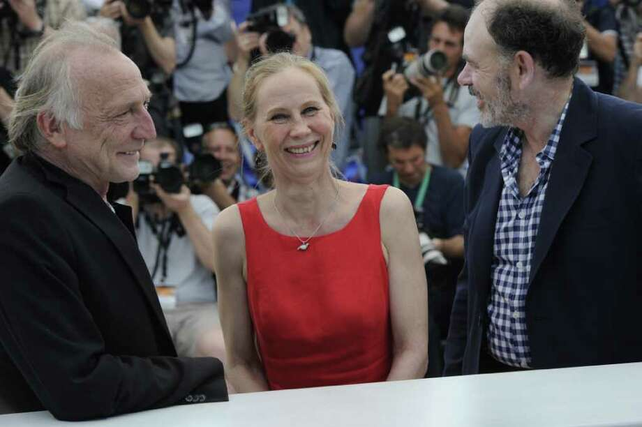 "(From L) French actor Andre Wilms, Finnish actress Kati Outinen and French actor Jean-Pierre Darroussin pose during the photocall of ""Le Havre"" presented in competition at the 64th Cannes Film Festival on Tuesday in Cannes.     AFP PHOTO / ANNE-CHRISTINE POUJOULAT Photo: ANNE-CHRISTINE POUJOULAT, AFP/Getty Images / 2011 AFP"