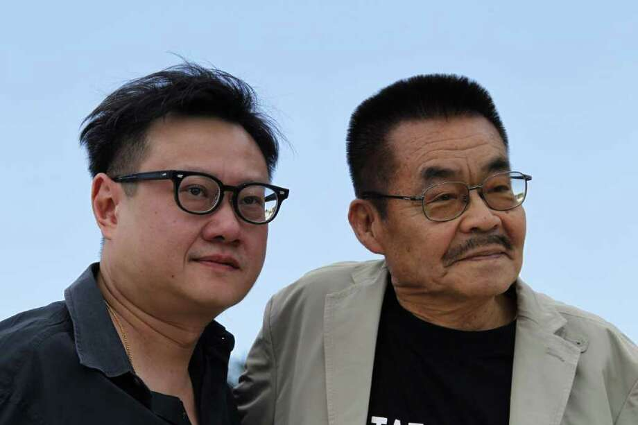 "Japanese director Eric Hoo (L) and Japanese actor Yoshihiro Tatsumi pose during the photocall of ""Tatsumi?"" presented in the Un Certain Regard Selection at the 64th Cannes Film Festival on Tuesday in Cannes.   AFP PHOTO / FRANCOIS GUILLOT Photo: FRANCOIS GUILLOT, AFP/Getty Images / 2011 AFP"