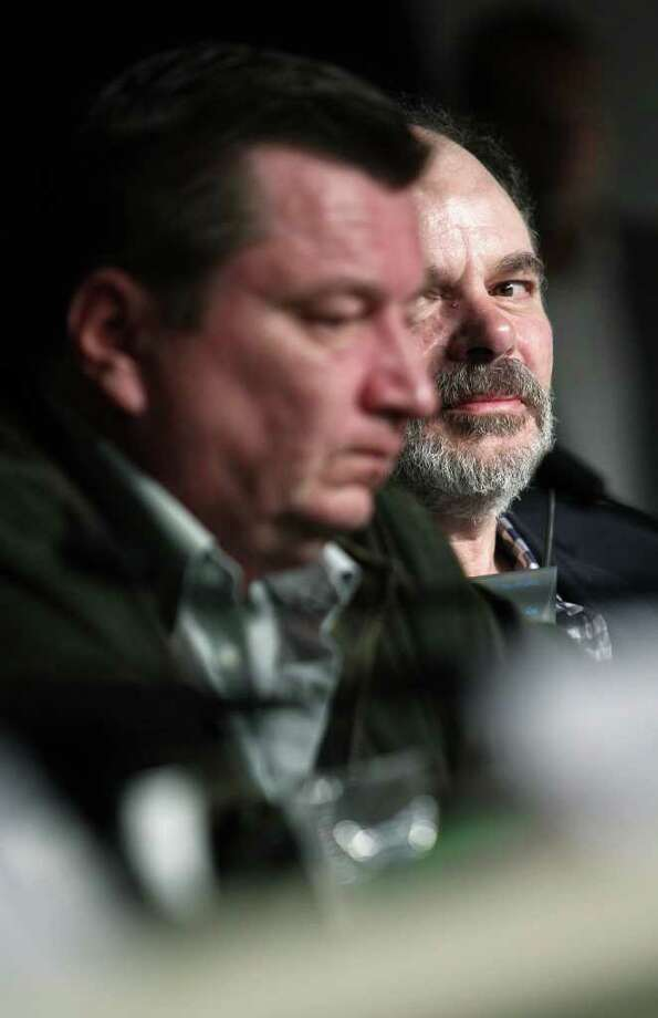 "French actor Jean-Pierre Darroussin (R) looks at Finnish director Aki Kaurismaki during the press conference of ""Le Havre"" presented in competition at the 64th Cannes Film Festival on Tuesday in Cannes.  AFP PHOTO / GUILLAUME BAPTISTE Photo: GUILLAUME BAPTISTE, AFP/Getty Images / 2011 AFP"