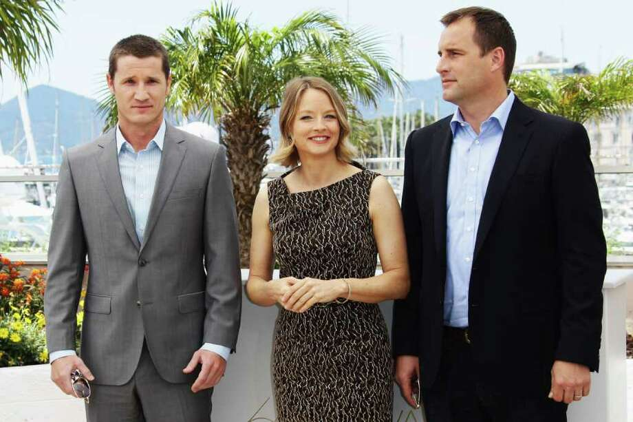 "Writer Kyle Killen, actress Jodie Foster and producer Keith Redmon attend ""The Beaver"" photocall at the Palais des Festivals during the 64th Cannes Film Festival on Tuesday in Cannes, France. Photo: Vittorio Zunino Celotto, Getty Images / 2011 Getty Images"