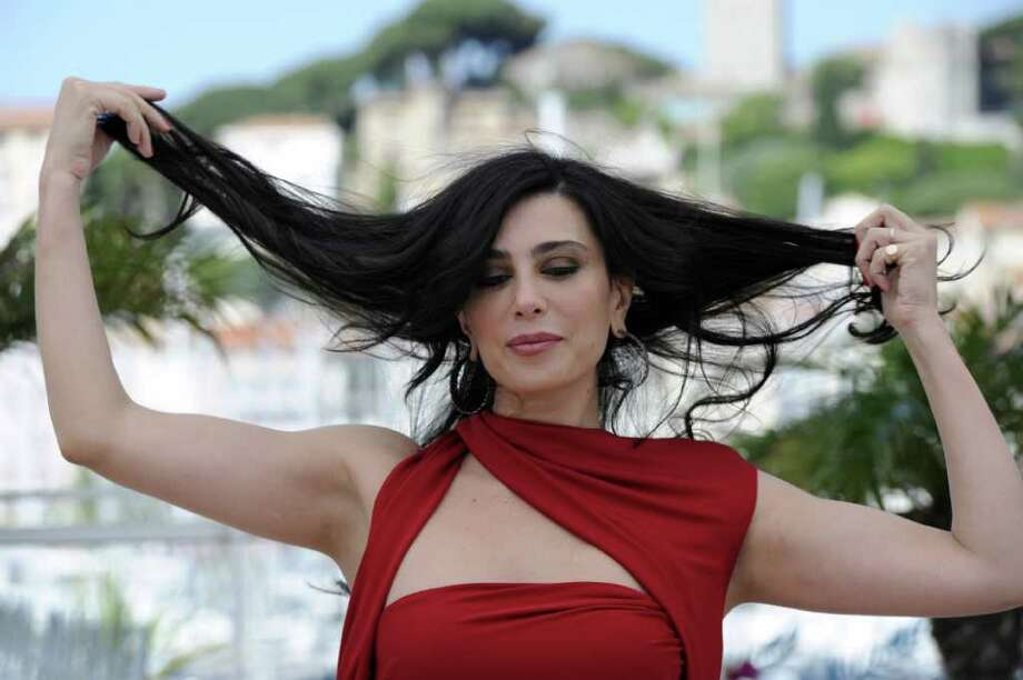 "Lebanese director Nadine Labaki poses during the photocall of ""Et Maintenant on Va Ou?"" (Where do We Go Now) presented in the Un Certain Regard Selection at the 64th Cannes Film Festival on Tuesday in Cannes.   AFP PHOTO / ANNE-CHRISTINE POUJOULAT Photo: ANNE-CHRISTINE POUJOULAT, AFP/Getty Images / 2011 AFP"