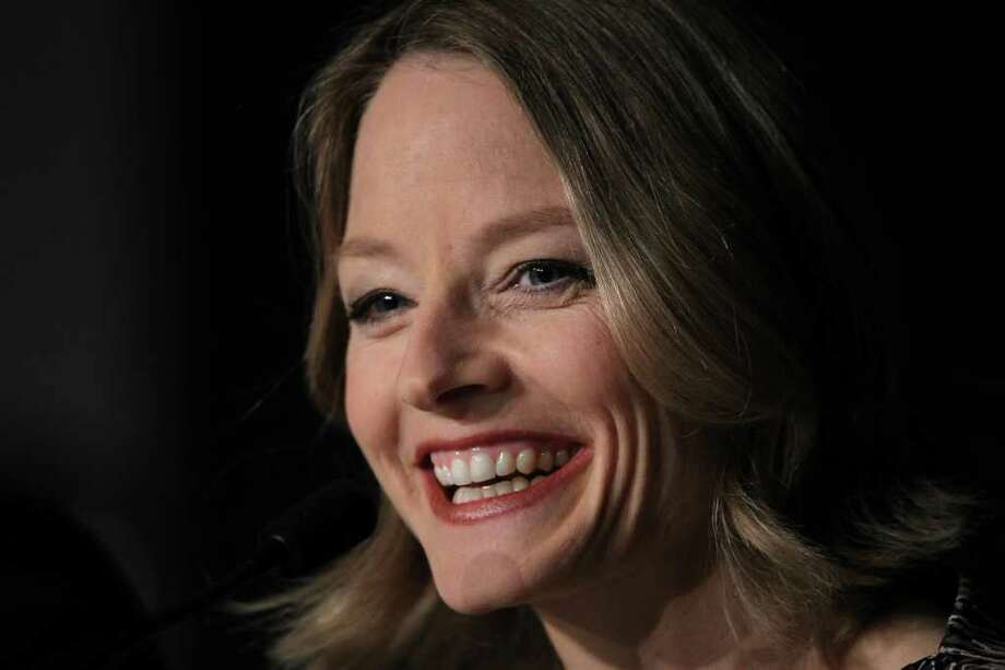 "Director and actress Jodie Foster smiles during the news of ""The Beaver"" presented out of competiton at the 64th Cannes Film Festival on Tuesday in Cannes.   AFP PHOTO / VALERY HACHE Photo: VALERY HACHE, AFP/Getty Images / 2011 AFP"