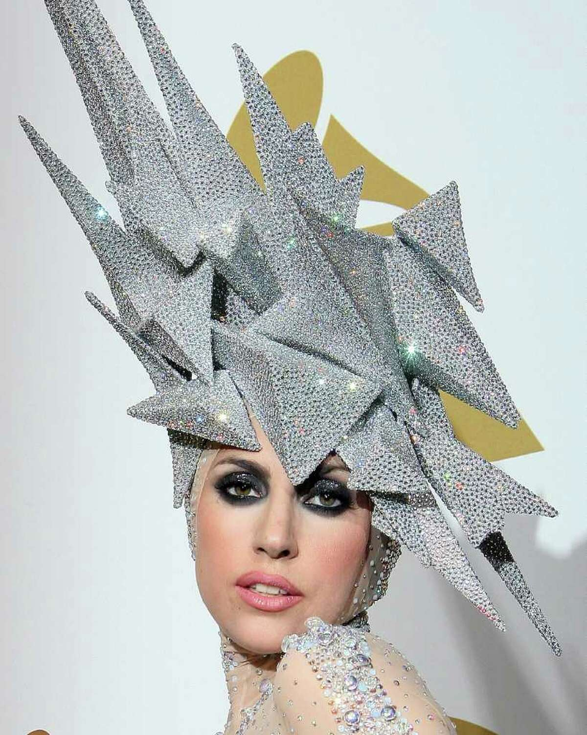 Lady Gaga poses with her awards during the 52nd annual Grammy Awards in Los Angeles, California on January 31, 2010.