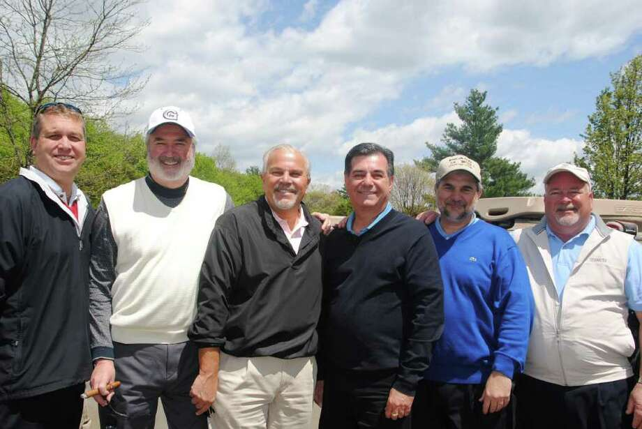 Among the 130 golfer participating in the 24th annual Umbrella Club Golf Outing are, from left, Umbrella Club member Christopher Gautrau of Stamford, Umbrella Club Corporate Sponsorship Committee Co-Chairman Tommy Heide of Stamford, former Lt. Gov. Mike Fedele of Stamford, Stamford Mayor Michael Pavia, New Canaan High School Principal Tony Pavia and Umbrella Club President Bruce Moore of Stamford. Photo: Contributed Photo / New Canaan News