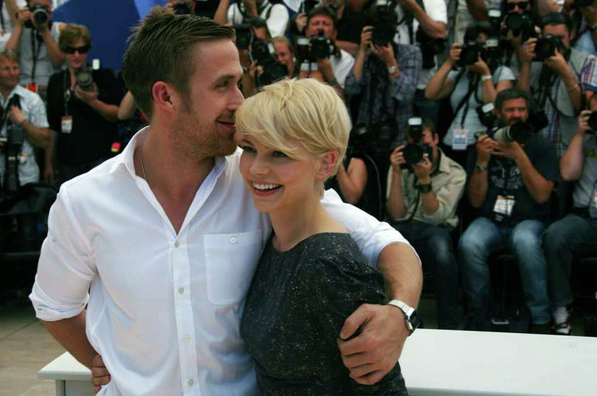 """Canadian actor Ryan Gosling and US actress Michelle Williams pose during the photocall of """"Blue Valentine"""" presented in the Un Certain Regard selection at the 63rd Cannes Film Festival on May 18, 2010 in Cannes. (LOIC VENANCE/AFP/Getty Images)"""