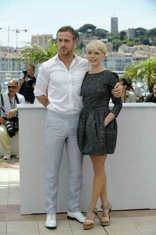 "US actress Michelle Williams and Canadian actor Ryan Gosling pose during the photocall of ""Blue Valentine"" presented in the Un Certain Regard selection at the 63rd Cannes Film Festival on May 18, 2010, in Cannes.  (AFP/Getty Images) Photo: ANNE-CHRISTINE POUJOULAT / AFP"