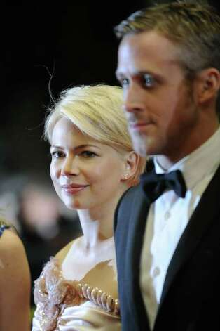 "US actress Michelle Williams and Canadian actor Ryan Gosling arrive for the screening of ""Blue Valentine"" presented in the Un Certain Regard selection at the 63rd Cannes Film Festival on May 18, 2010, in Cannes.  (ANNE-CHRISTINE POUJOULAT/AFP/Getty Images) Photo: ANNE-CHRISTINE POUJOULAT / AFP"