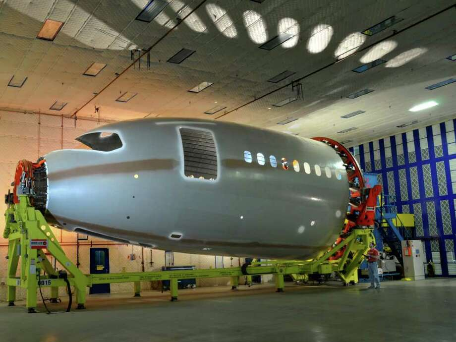 Workers build Boeing 787 Dreamliner forward fuselage sections at the company's facility in Wichita, Kan. Photo: Spirit Aerosystems