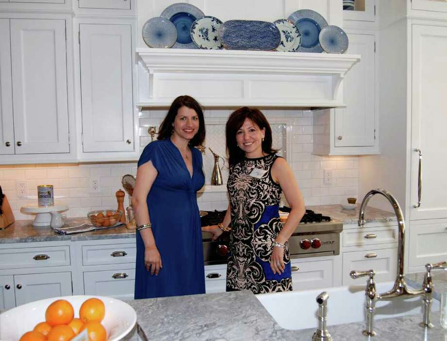 Kathleen Walsh of Kathleen Walsh Interiors and Veronica Campbell of Deane stand in the kitchen that they created on Brushy Ridge.  Kathleen Walsh Interiors was one of three major sponsors of the tour. Photo: Jeanna Petersen Shepard / New Canaan News