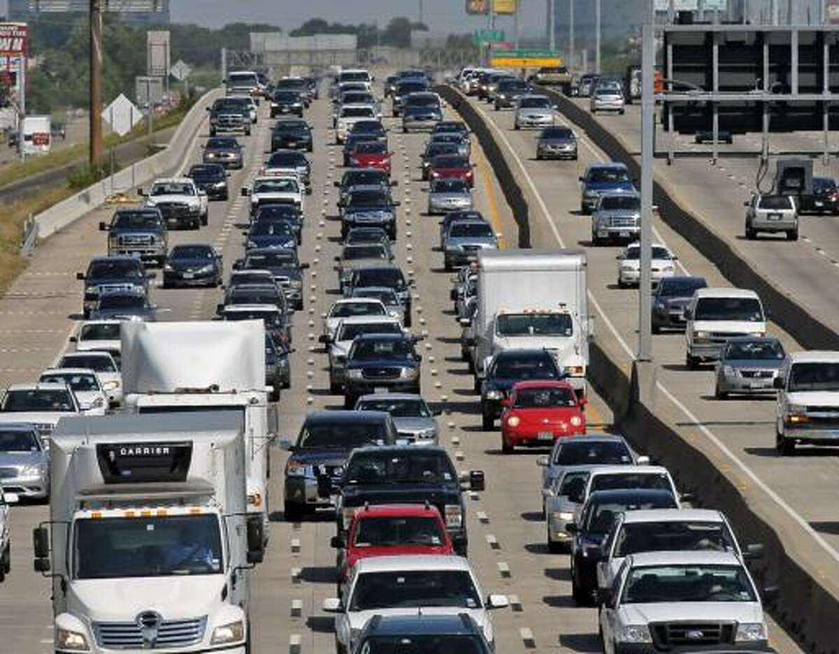ONE BUSY ROAD: U.S. 290 traffic heads west at the West Little York overpass on Friday afternoon.