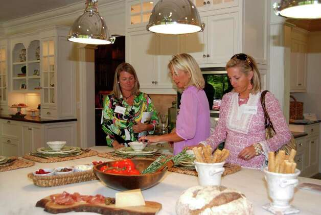 Susie Swindell. Adair Scott, and Marnie Miller admire the Smith Ridge kitchen design. Photo: Jeanna Petersen Shepard / New Canaan News