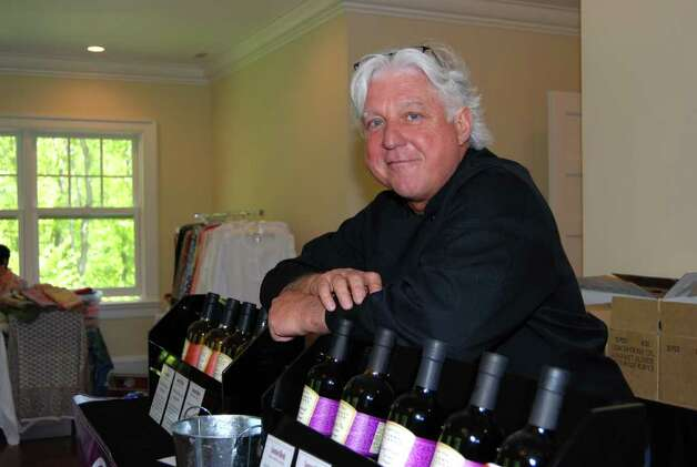 Paul Scott of East End Foodies, Inc., sells his custom Napa-blended extra virgin oils. Photo: Jeanna Petersen Shepard / New Canaan News