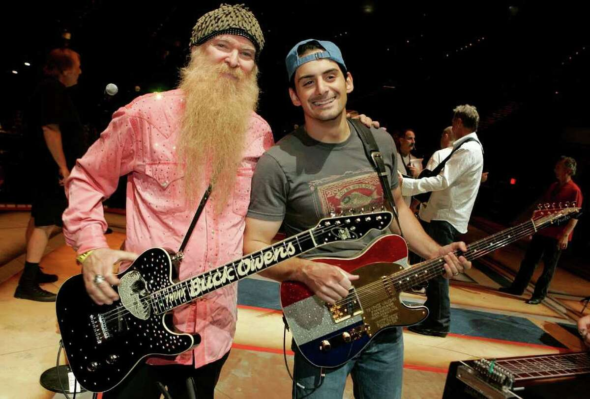 LAS VEGAS - MAY 22: Musicians Billy Gibbons (L) of ZZ Top and Brad Paisley pose for photos onstage during the rehearsals for Academy of Country Music Awards held at the MGM Grand Garden Arena on May 22, 2006 in Las Vegas, Nevada. (Photo by Kevin Winter/Getty Images)