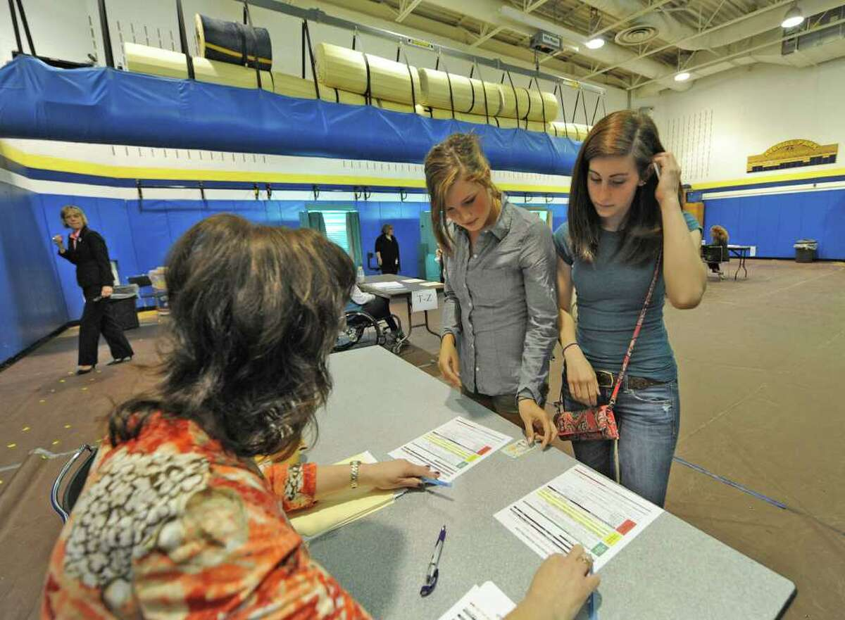 Sarah Boyle, left, and Carlene Benson vote for the first time on the school budget at Averill Park High School in Averill Park, N.Y. May 17, 2011. (Skip Dickstein/ Times Union)
