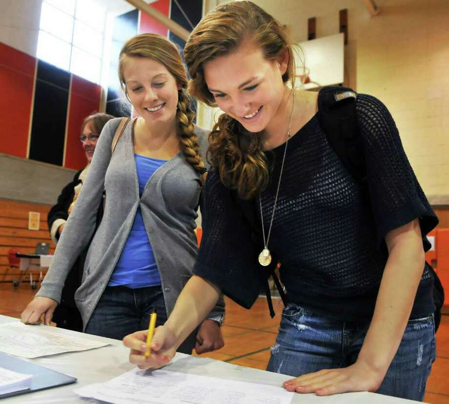 First-time voters Veronica Lane, left, and Megan Perry sign in for Bethlehem High School's budget vote on Tuesday, May 17, 2011.   (John Carl D'Annibale / Times Union) Photo: John Carl D'Annibale / 00013078B