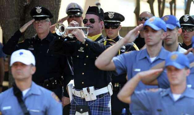 Taps is played during a tribute to fallen San Antonio Police Officers Tuesday May 17, 2011. JOHN DAVENPORT/jdavenport@express-news.net
