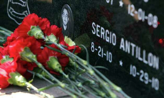 Flowers are placed in tribute to San Antonio Police Officer Sergio Antillon at  a tribute to fallen officers at the Police Traing Academy Tuesday May 17, 2011. JOHN DAVENPORT/jdavenport@express-news.net